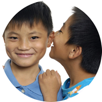 Two Children Whispering Into Each Others Ear | Fastrackids