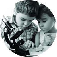 Two kids learning micro scope | Fastrackids
